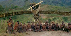 Photo of Melanesians with bamboo plane